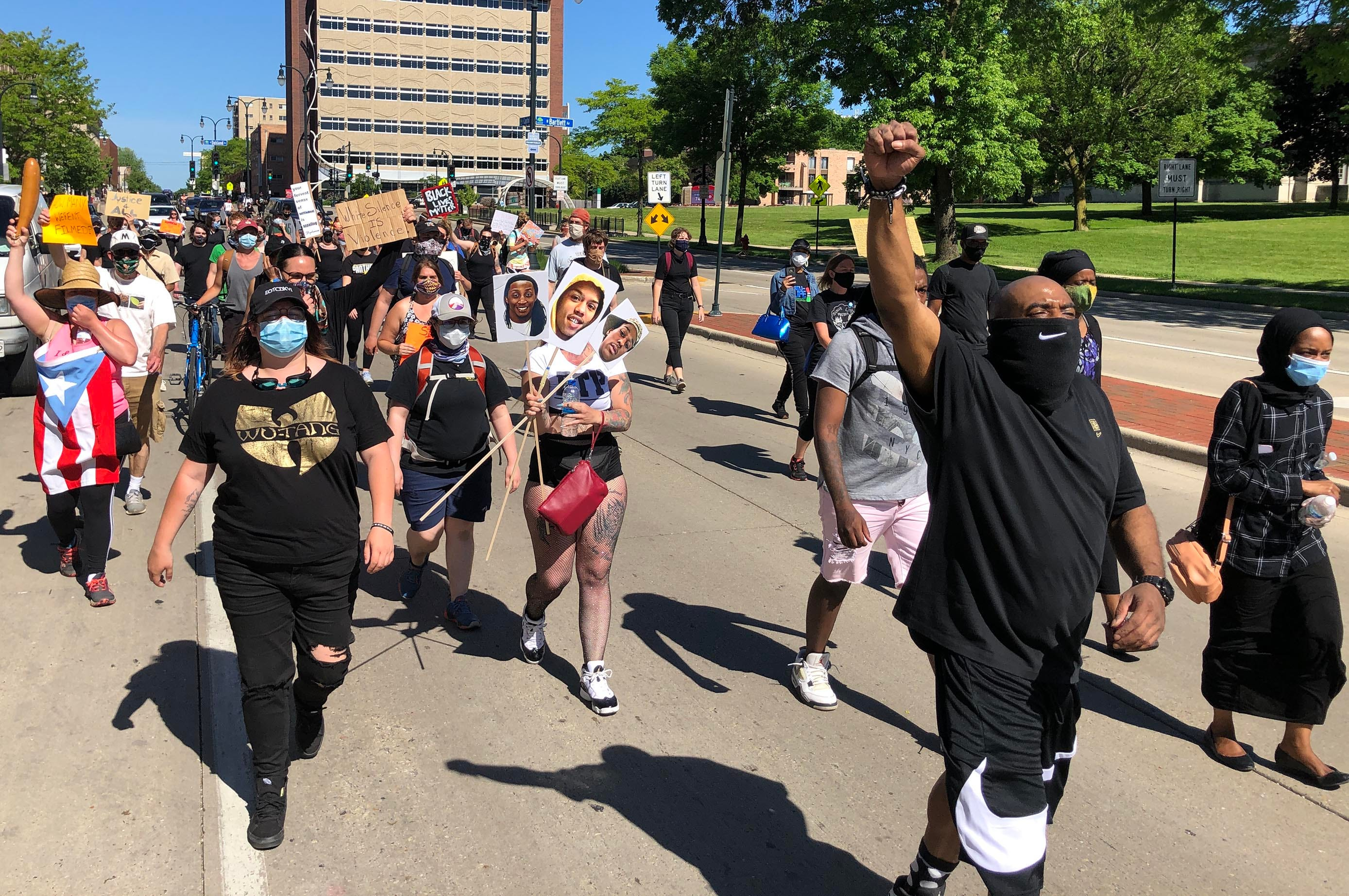 """A group of about 100 protesters chant """"Justice, No Peace,"""" as they march on Capitol Drive between Shorewood and Milwaukee to call attention to racial injustice and to support the Black Lives Matter movement on Monday, June 8, 2020."""