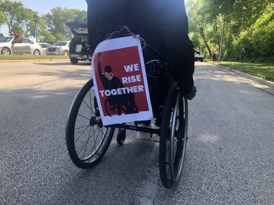 People using wheelchairs and other mobility aids led protesters June 7 in Milwaukee.