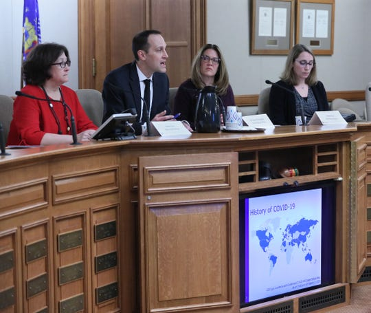 Wisconsin Department of Health Services officials brief lawmakers on the coronavirus outbreak at the state Capitol in this March 4 file photo. State Health Officer Jeanne Ayers, left, was asked to resign in early May amid the pandemic and DHS officials won't say why.