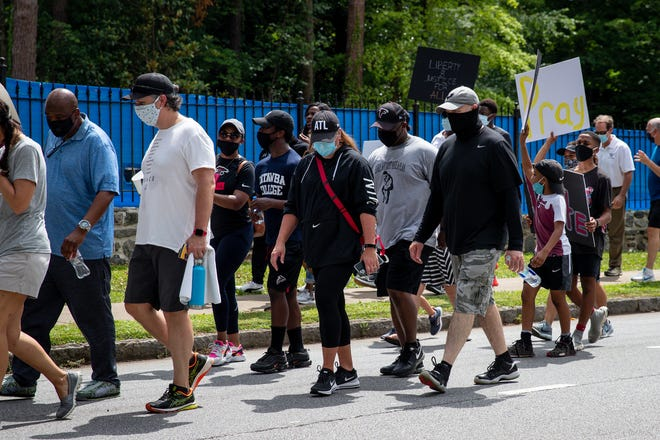 Atlanta Falcons coaches, players, staff and alumni marched alongside ATLiens during the Buckhead for Black Lives protest event to the Governor's mansion in Atlanta, Georgia, on Sunday June 7, 2020. (Photo by Kara Durrette/Atlanta Falcons)