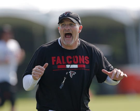 FILE - In this July 27, 2017, file photo, Atlanta Falcons head coach Dan Quinn works with his defensive linemen during the first day of an NFL training camp football practice in Flowery Branch, Ga. Quinn knows this is an offseason unlike any other. Hes not shying away from that reality. But this is also a time that craves a bit of normality, so Quinn is dealing with plenty of familiar issues, including rookie camp, roster moves, position changes, and focusing on areas that need the most improvement. (AP Photo/John Bazemore, File)
