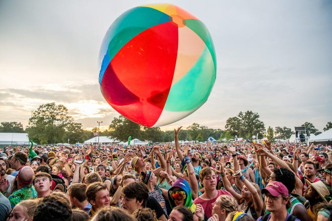 The crowd passes around a giant inflatable ball as Moon Taxi performs at Bonnaroo in Manchester, Tenn. June 10, 2018.