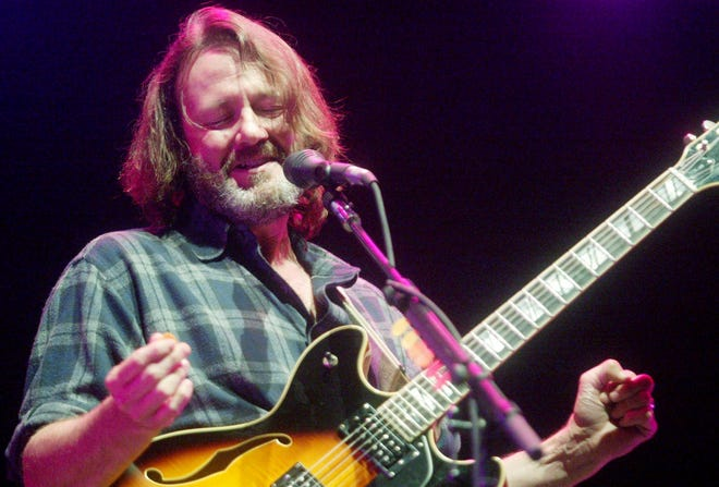 John Bell of Widespread Panic performs to a screaming audience at Bonnaroo on June 14, 2003. The band postponed three Austin shows after Bell tested positive for COVID-19.