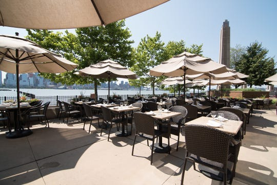 Dine alfresco at Son Cubano's expansive patio overlooking the Hudson River.