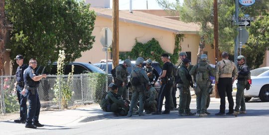 Members of the Las Cruces Police Department SWAT team rest on Tornillo Street Monday June 8, 2020.