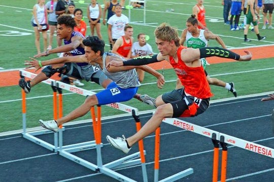 Carlsbad's Caleb Macias (center) runs the hurdles during the 2019 season. Macias signed with ENMU and will compete in the decathlon for the Greyhounds next season.