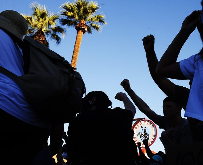 Protesters take a knee during a march against racism and police brutality in Old Town Scottsdale on June 7, 2020.