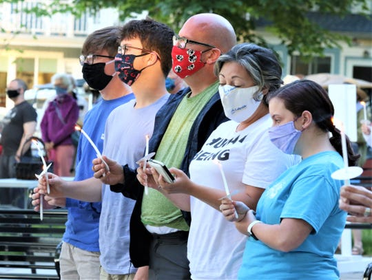Candles were lit during Lakeside Chautauqua's service for peace, justice, and healing held Sunday.