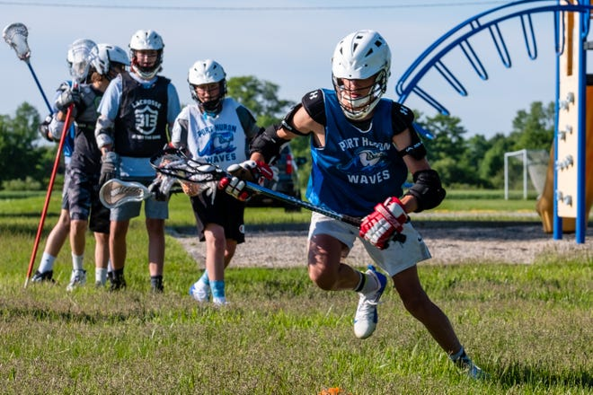 Port Huron Northern freshman Silas Klink, 14, runs drills during a Port Huron Waves lacrosse practice Monday, June 8, 2020, at Bill Bearss Memorial Park. Many local sports teams and groups resumed practices this week.