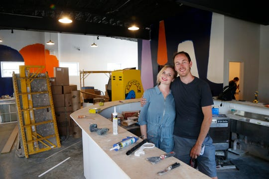 Happy Valley Arcade Bar owners amid the construction in the bar & arcade in Beacon on June 8, 2020.