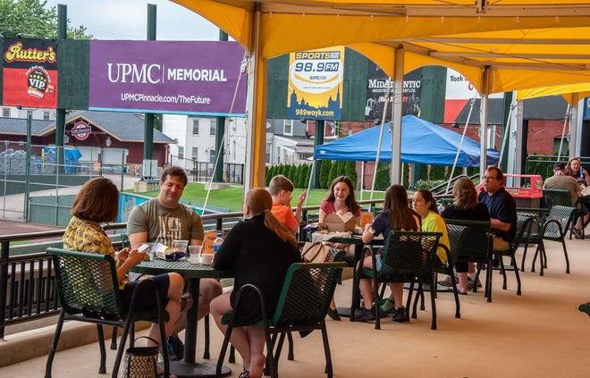 Folks are shown dining during a patio party at PeoplesBank Park last weekend. York Revolution officials said the outdoor parties will continue each Friday and Saturday through the end of June.