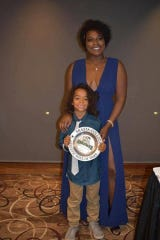 Former Redding athlete Ravien Lawson poses with her son Johnnie when she was inducted into the Shasta College Sports Hall of Fame on Oct. 23, 2017.