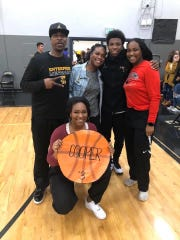 """Ravien Lawson, center, poses with her father Lamont """"Disco"""" Cooper, left, brother Demarreya Lewis-Cooper, right center, sister Alex Cooper, right, and sister Justyse Cooper, bottom, in a photo taken in 2020."""