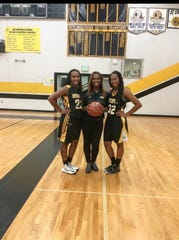 Former Enterprise assistant girls basketball coach Ravien Lawson (center) coached her sisters Alex (left) and Justyse (right) Cooper when they were in high school.