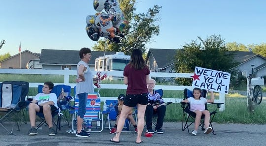 West Valley community members wave congratulatory signs and cheer for the West Valley 2020 graduating senior class during the Graduation cruise.