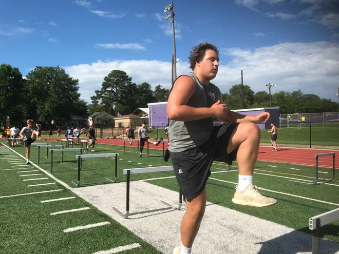 Byrd's Carson Bruno jumps a hurdle during the Jackets' first group workouts following the coronavirus suspensions.