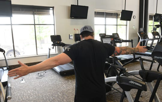 Sauk Rapids Anytime Fitness co-owner John Schultz shows the need to spread equipment 6 feet apart Monday, June 8, 2020, in Sauk Rapids.