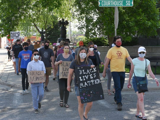 Public defender Beth Lee leads a march of protesters down the Courthouse Square Monday, June 8, 2020, in St. Cloud. The march was in connection with a nationwide march of public defender's across the country.