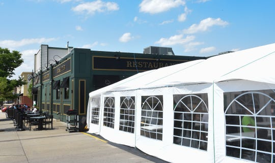 Jimmy's Pour House has added a tent in their parking lot in addition to their patio seating Monday, June 8, 2020, in Sauk Rapids.