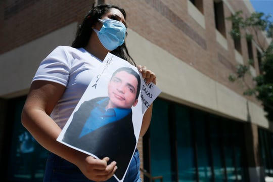 A protester holds a photo of Erik Salas-Sanchez as the Border Network for Human Rights holds a community protest on Monday, June 8, 2020, at El Paso City Hall demanding justice in the police-related deaths of Erik Salas-Sanchez in El Paso and George Floyd in Minneapolis.