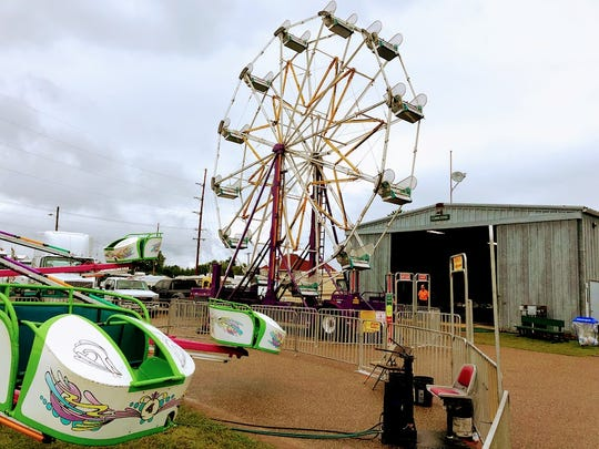This Ferris Wheel stands idle at the Waushara County Fair last year. Nearly two dozen county fairs have announced the cancellation of their yearly event.