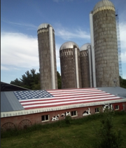 A large hand-painted American flag graces the roof of the Spaulding family farm near Shell Lake, Wis.