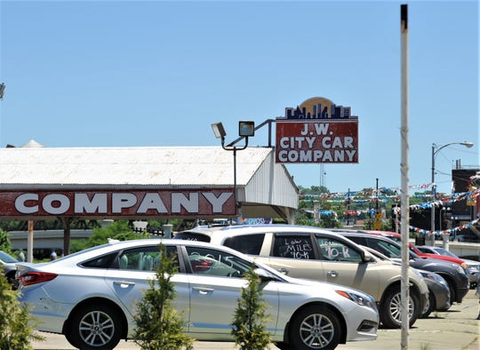 City Council approved the ordinance for a purchase agreement with Raymond Wilkes for property on West Main Street. The current parcel is home to J.W. City Car Company.