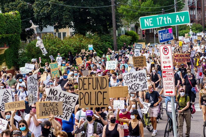 Demonstrators march against racism and police brutality and to defund the Minneapolis Police Department on June 6, 2020, in Minneapolis,  part of a wave of such protests in the wake of George Floyd's death.