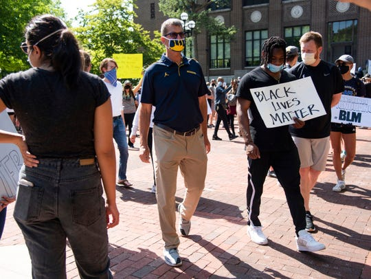Michigan head football coach Jim Harbaugh attends a Black Lives Matter protest in Ann Arbor, Mich., on  June 2, 2020.