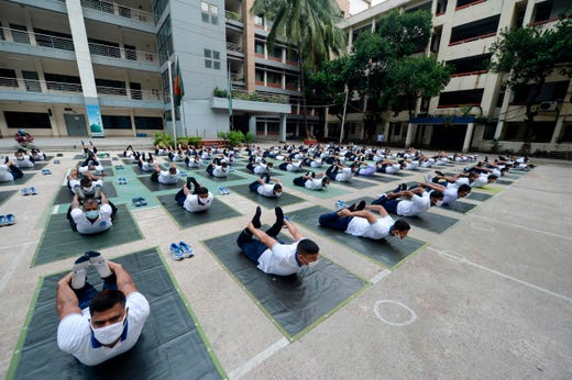 Members of the Bangladesh police attend a yoga session to boost the immune system of police personnel during the COVID-19 coronavirus pandemic, in Dhaka on July 8, 2020.