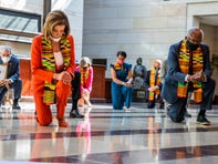 House Speaker Nancy Pelosi of Calif., center, and other members of Congress, kneel and observe a moment of silence at the Capitol's Emancipation Hall, Monday, June 8, 2020, on Capitol Hill in Washington, reading the names of George Floyd and others killed during police interactions. Democrats proposed a sweeping overhaul of police oversight and procedures Monday, an ambitious legislative response to the mass protests denouncing the deaths of black Americans at the hands of law enforcement.