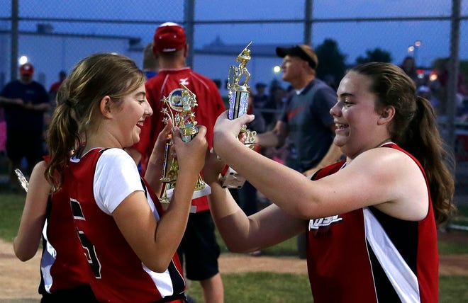 Samantha Linn, left and Eryn Lemmert of Kolosso Toyota celebrate their win over the Timber Rattlers in the Appleton Little League softball championship game in 2018 at Scheels USA Youth Sports Complex.