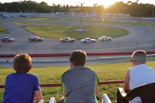Marcus Manschot, left, Brayden Meyerhofer-Hietpas, center, and Logan Kappell watch Fox River Racing Club action on June 4 at the Wisconsin International Raceway.  Wm. Glasheen USA TODAY NETWORK-Wisconsin