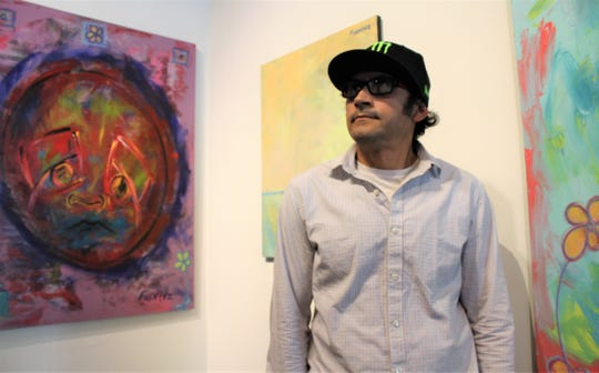 "Artist Anthony Fuentez stands among his many new works for ""A Reflection of Who I Have Become,"" his solo show at The Center for Contemporary Arts."
