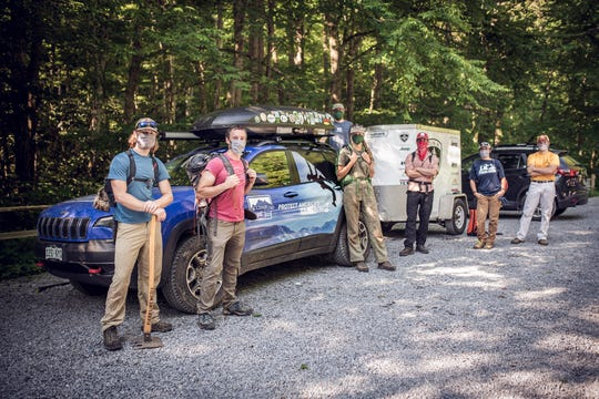 Members of the Carolina Climbing Conservation Corp, a hired crew of people who lost their jobs due to the COVID-19 crisis, get ready for work at Rocky Fork State Park in Tennessee recently.