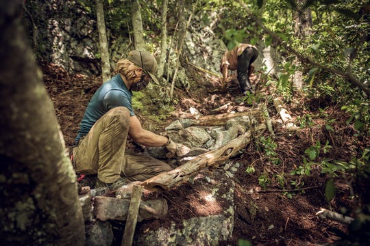 Members of the Carolina Climbing Conservation Corp, a hired crew started by the nonprofit Carolina Climbers Coalition, work on trail building in Rock Fork State Park in Tennessee recently.