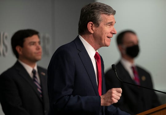 Governor Roy Cooper holds a press briefing at the Emergency Operations Center on Monday, June 8, 2020 in Raleigh, N.C. Cooper updated the public on the COVID-19 virus and response to protests for racial justice. (Robert Willett/The News & Observer via AP)