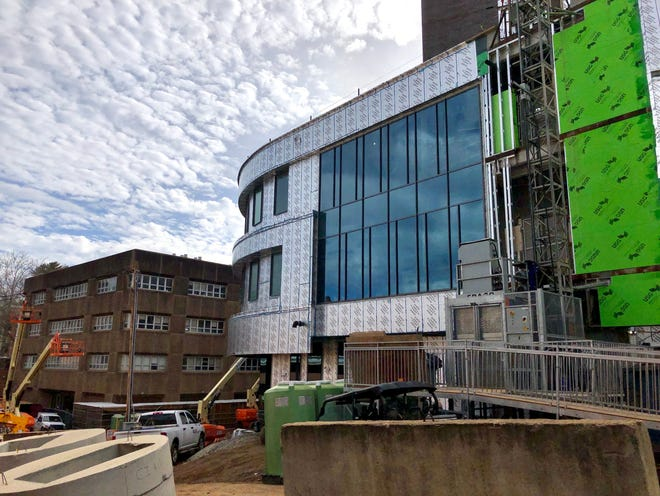 The new Apodaca science building on the Western Carolina University campus will eventually replace the Natural Sciences Building in the background. A cluster of COVID-19 cases emerged on the work site in April, but it was contained by mid-May, 2020, officials said.