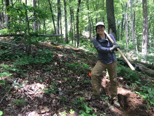 Danielle Johnson, of Asheville, is a member of an eight-person crew with C4, aka the Carolina Climbing Conservation Corp, a hired crew of people who lost their jobs due to the COVID-19 crisis, working on trail building and maintenance.