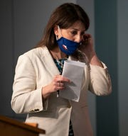Dr. Mandy Cohen, Secretary of the North Carolina Department of Health and Human Services, adjusts her face covering after a press briefing on the COVID-19 virus at the Emergency Operations Center on Monday, June 8, 2020 in Raleigh, N.C. (Robert Willett/The News & Observer via AP)
