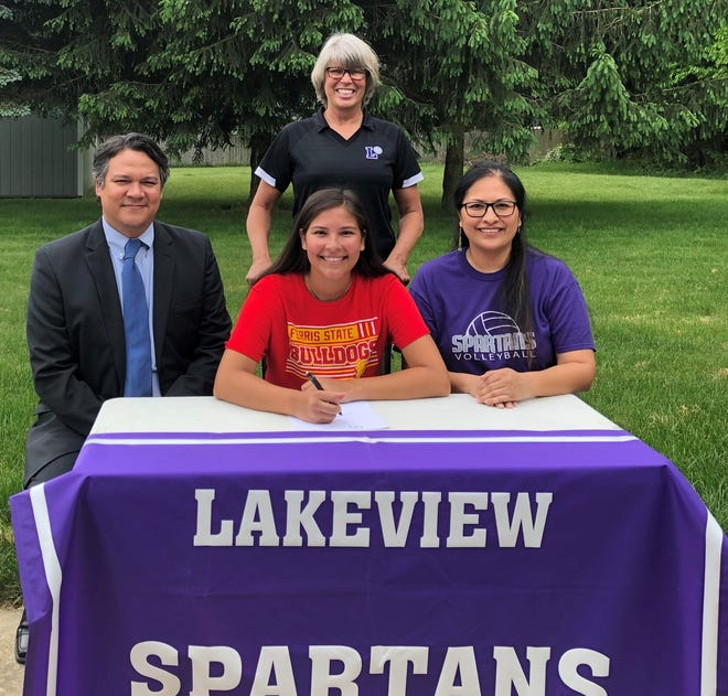Lakeview's Hannah Tecumseh celebrates her commitment to Ferris State University to play volleyball at a ceremony from home with her parents and coach.