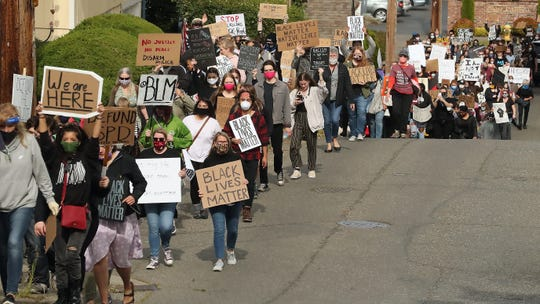 Protesters march from Evergreen Rotary Park up 17th street to the Warren Avenue Bridge on Monday, June 8, 2020. The demonstration, organized by Bremerton youth, followed more than a week of largely peaceful protests throughout the county after the death of George Floyd sparked worldwide outrage against police brutality and systemic racism.