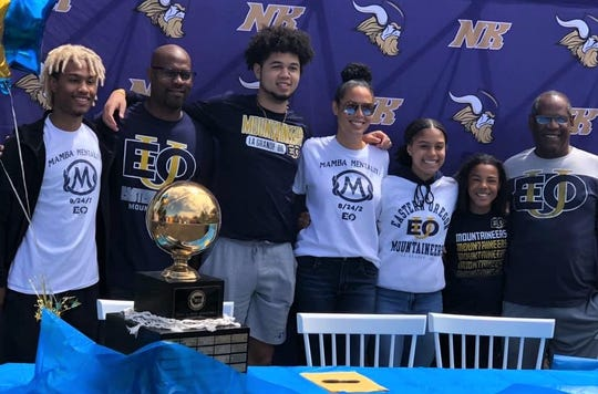 North Kitsap's Shaa Humphrey (third from left) gathers with family members after signing to play at Eastern Oregon University.