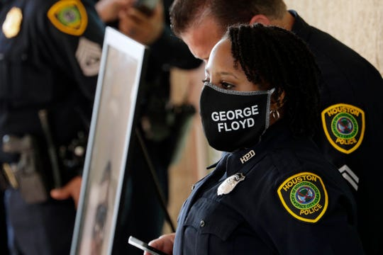 Houston police stand watch at George Floyd's funeral Tuesday, June 9, 2020, in Houston at The Fountain of Praise church.(AP Photo/Eric Gay)