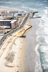 A flat beach, sea wall and pier with multiple businesses (top of photo) in North Wildwood after dunes and vegetation removal, which prompted the state to issue a stop work order and wetlands and other coastal violation notices against the city the first week of 2020
