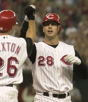 Mike Bell's big-league career only lasted 19 games with the Cincinnati Reds in 2000. Here he is pictured after hitting his first career home run. Friday night was only the second time that Mike Bell, a coach for the Minnesota Twins, and brother David Bell competed on the same big-league field.