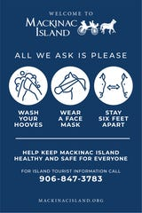 Signs on the streets of Mackinac Island this season offer health guidelines to stay safe during the COVID-19 pandemic.