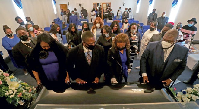 Church members and family of East Side Unity Church of God in Christ say their final good bye to Administrative Assistant Robert Butts, Jr. Saturday, May 9, 2020. Butts passed away April 27, 2020 from complications due to COVID-19.