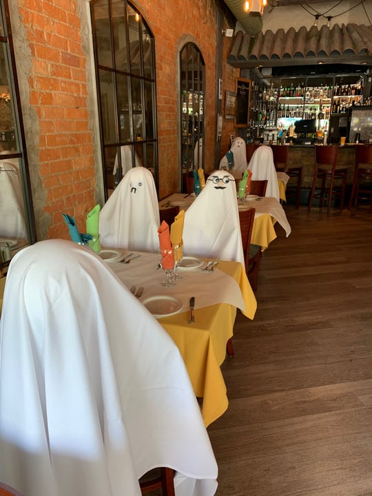 Ghosts are set up at tables as a fun way to promote social distancing Inside Trattoria Pizzeria da Luigi in Royal.