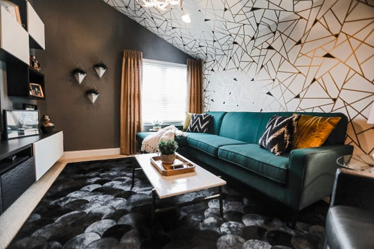 Geometric wallpaper accents the shape of the ceiling in Jerry and Lisa Zimmer's TV room. The wall-mounted cabinets are from IKEA.